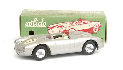 Solido Porsche Spyder - metallic silver, green tonneau, red steering wheel, driver, racing number 7, gold headlights, spun hubs - Near Mint to Mint in Excellent green box