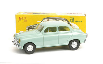 Paya 1/32nd scale plastic friction drive Seat 1400 B - light blue, plastic body, yellow interior, dark green tinplate base - Excellent (both rear hubs fatigued and friction drive motor non operational) in Excellent box
