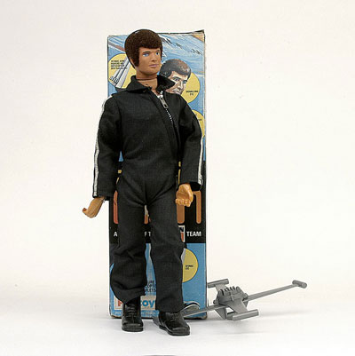 A Palitoy Action Man Atomic 1970s Dark Brown Flock Hair Automatic Signalling Eye Heart Pacer Leg And Arm Dressed In Original Black