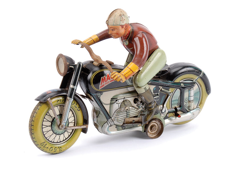 Arnold (Made in US Zone) Mac 700 Motorcyclist - with black and silver bike, green tyres, green and brown rider, in full working order - some surface rust showing to handlebars and around headlamp rim but otherwise Good Plus to Excellent