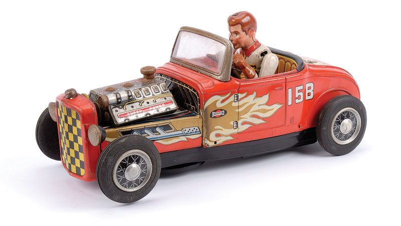 TN (Japan) Superpower Hot Rot Car, battery driven - red body with silver and red exposed engine with gold flames to side of body, white and green driver - some minor surface rust to bright parts, 26cm long - Good Plus