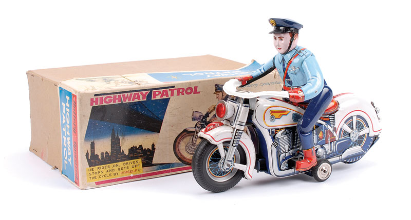 Modern Toys (Japan) battery operated Highway Patrol Motorcycle and rider where the rider rides on, drives, then stops and steps off the bike - white bike, two tone blue rider with dark blue cap and detailed tinprinting of engine