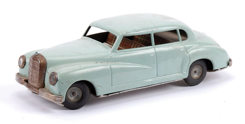 Arnold (Germany) or similar Mercedes 4 door Saloon - very pale blue, detailed tartan pattern tinplated interior, friction drive (require some attention), steerable front wheels