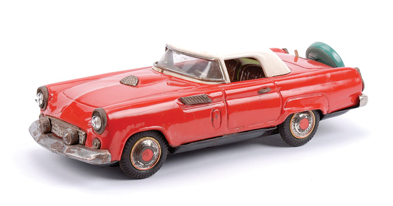 Unknown make (Japanese) tinplate battery operated Ford Thunderbird in red with white roof, detailed tinprinted interior, spare wheel to boot - has some tarnishing to bright parts - generally Good to Good Plus, 29cm long