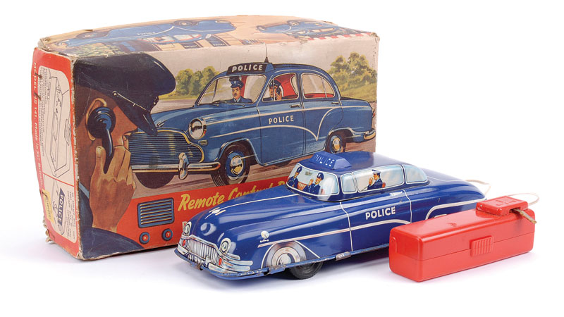 Wells Toy (Great Britain) remote control battery operated Police Car - dark blue car, printed detail to windows - a few minor blemishes but generally Excellent, 29cm long in Good detailed picture box