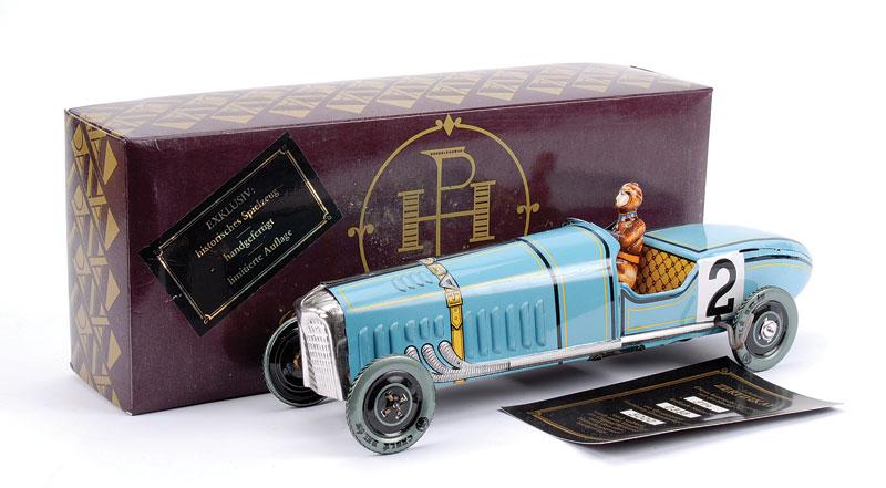 Paya (Spain) modern reissue Racing Car - pale blue, driver, yellow tinprint interior, racing number 2, clockwork in working order being No