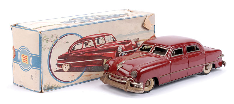 SG (Guntherman Made in US Zone Germany) clockwork 4 door Sedan - maroon, chromed detail, Stop and Go and forward and reverse mechanisms in working order, black tinprinted base with chassis and engine detail - bright work is tarnished else overall Good Plu