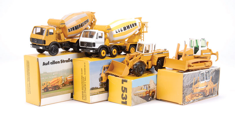 Conrad group of 4 Liebherr models to include - (1) 531 Wheel Loader, (2) PR722 Crawler Tractor, (3) Mercedes Cement Truck HTM604 and (4) Mercedes Cement Truck HTM904 - conditions are generally Near Mint to Mint in Excellent Plus to Mint carded picture box