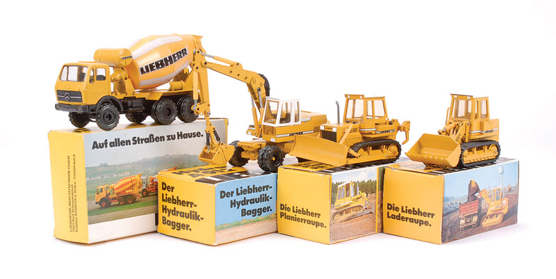 Conrad group of 4 Liebherr models to include - (1) Mercedes Cement Mixer HTM603, (2) PR731 Crawler Tractor with rear attachment, (3) 621 Loader and (4) A912 Hydraulic Bagger - all are generally finished in mustard, white, black including rubber tracks - c