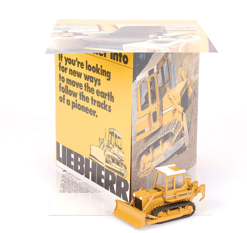 Gescha Liebherr Promotional Pack which contains Liebherr 731 Tractor with front blade and rear attachment - comes in presentation fold-out box which is Mint including outer original carton - see photo