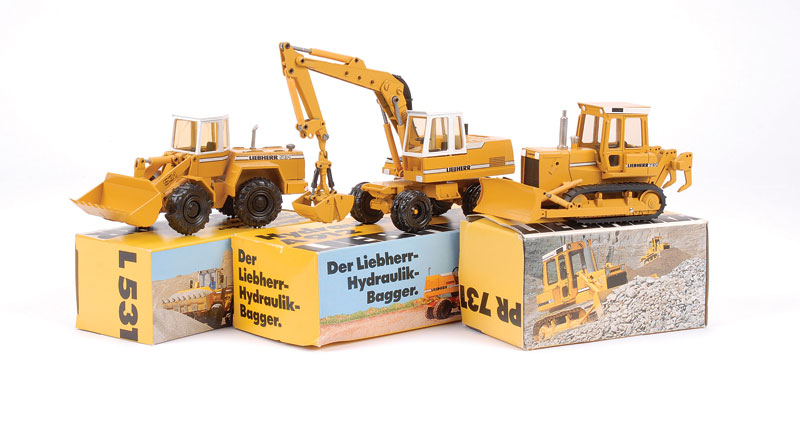 Conrad group of 3 Liebherr models to include - (1) PR731 Crawler Tractor with rear attachment, (2) 531 Wheel Loader and (3) A912 Hydraulic Bagger - all are generally finished in mustard, white, black including rubber tracks - conditions are Near Mint to M