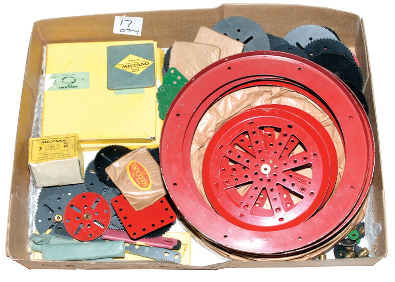 Meccano large quantity of loose and factory pack parts including 167B flanged rings x 7, 3 still wrapped in original factory brown paper, pulleys, gear wheels a number still with original price and part number tags, gears, together with unopened packets f