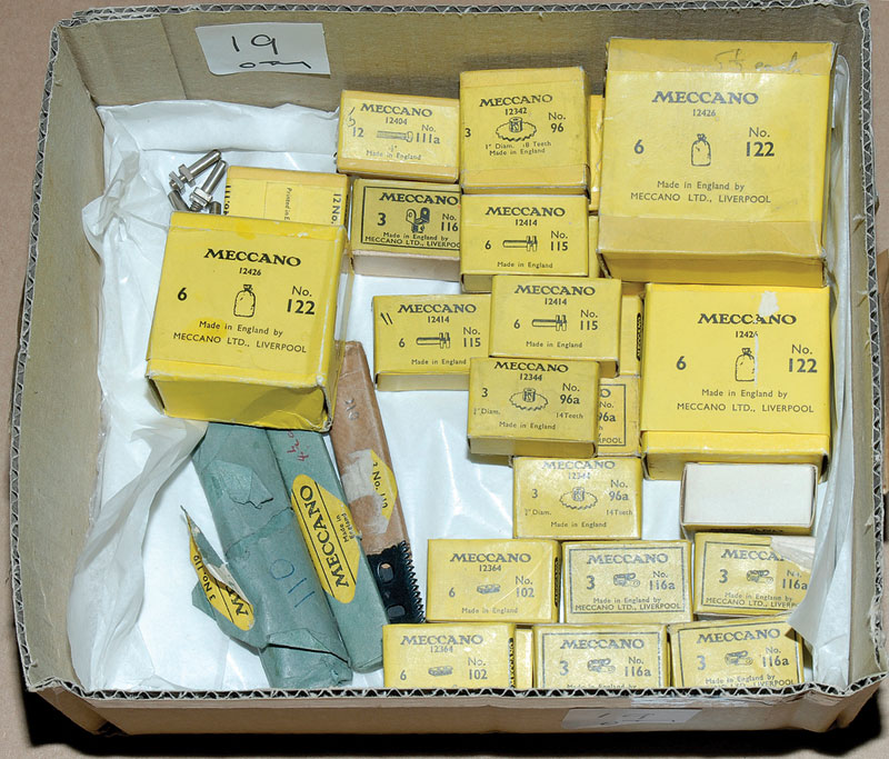 Meccano quantity of parts mostly in factory yellow and other type packaging including 122 sacks x 2 (6), 96 and 96A sprocket wheels x 6, 102 flat girders x 3, 115 threaded pin x 5, 116A fork piece x 7 and a small quantity of other items