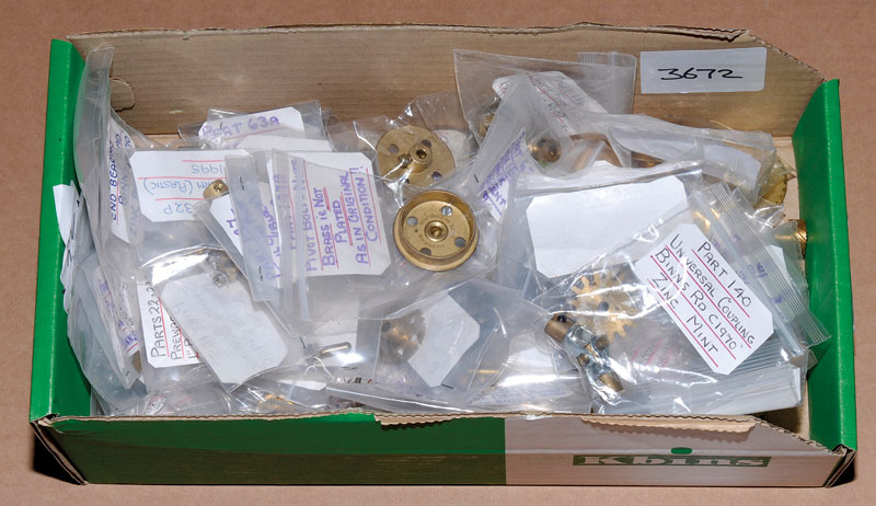 Meccano large quantity of brass ware many in individual bags including 167C 16 tooth pinion, brush wheel, cone pulley, bevel gears, coupling, threaded bolt, universal coupling, helical gears amongst other items