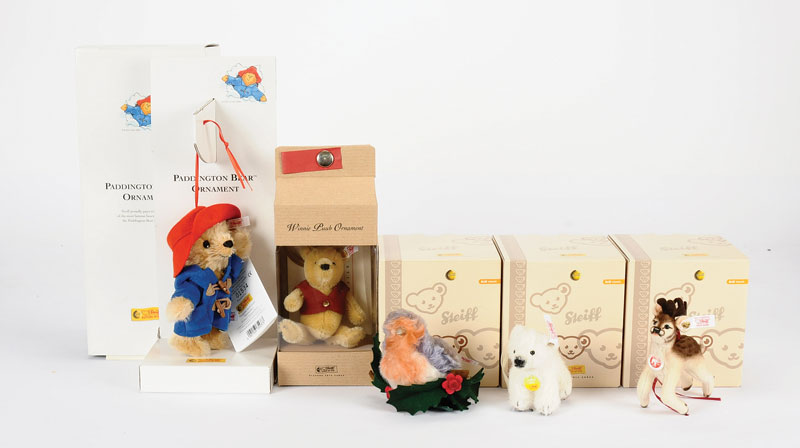 Steiff a collection of Christmas Ornaments including: Paddington Bear ornament, white tag 354373, LE 5000, 2004, Mint including certificate and Near Mint box; Winnie the Pooh ornament, LE 680113, Limited Edition to the year 2001, Mint including certificat